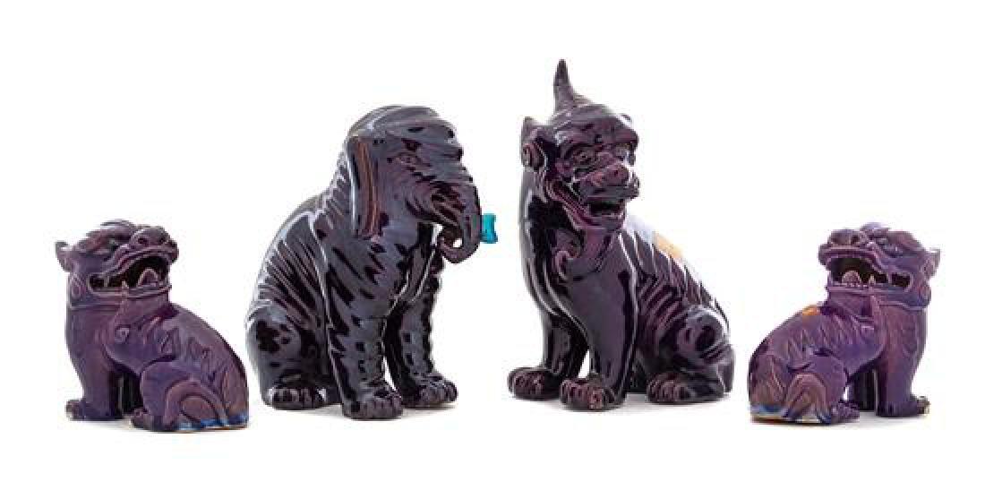 * Four Aubergine Glazed Porcelain Animal Figures Height