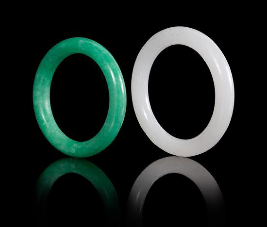 Two Jadeite Bangles Diameter of larger 3 3/8 inches.