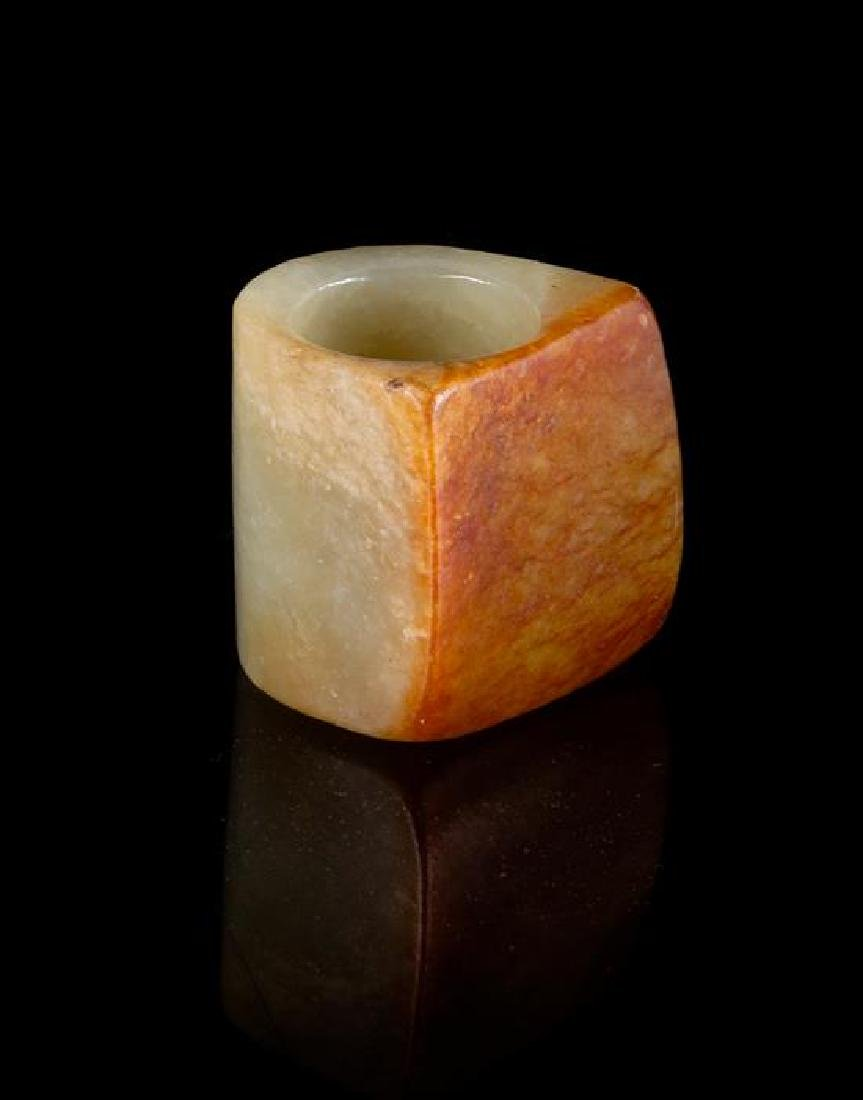 A Celadon and Russet Jade Archer's Ring Length 1 1/8 - 2