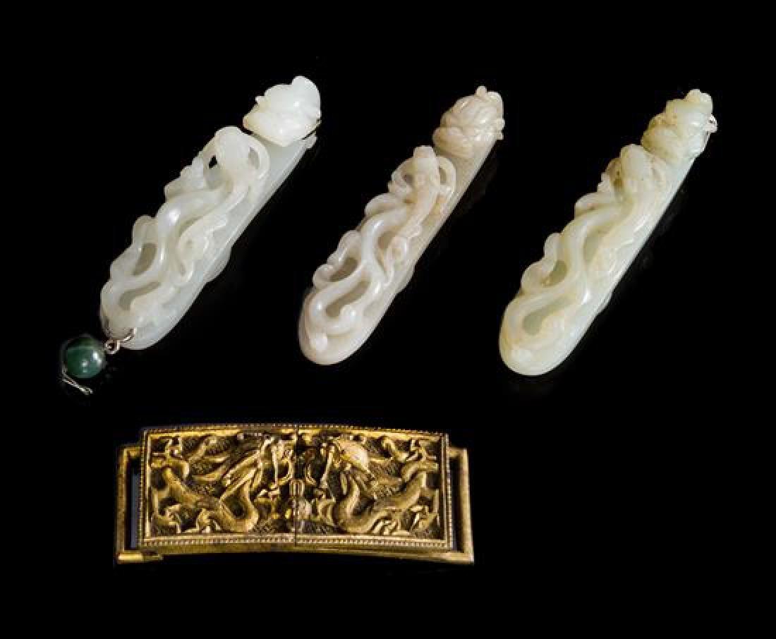 * Three Carved Jade Belt Hooks Length of longest 3 1/2
