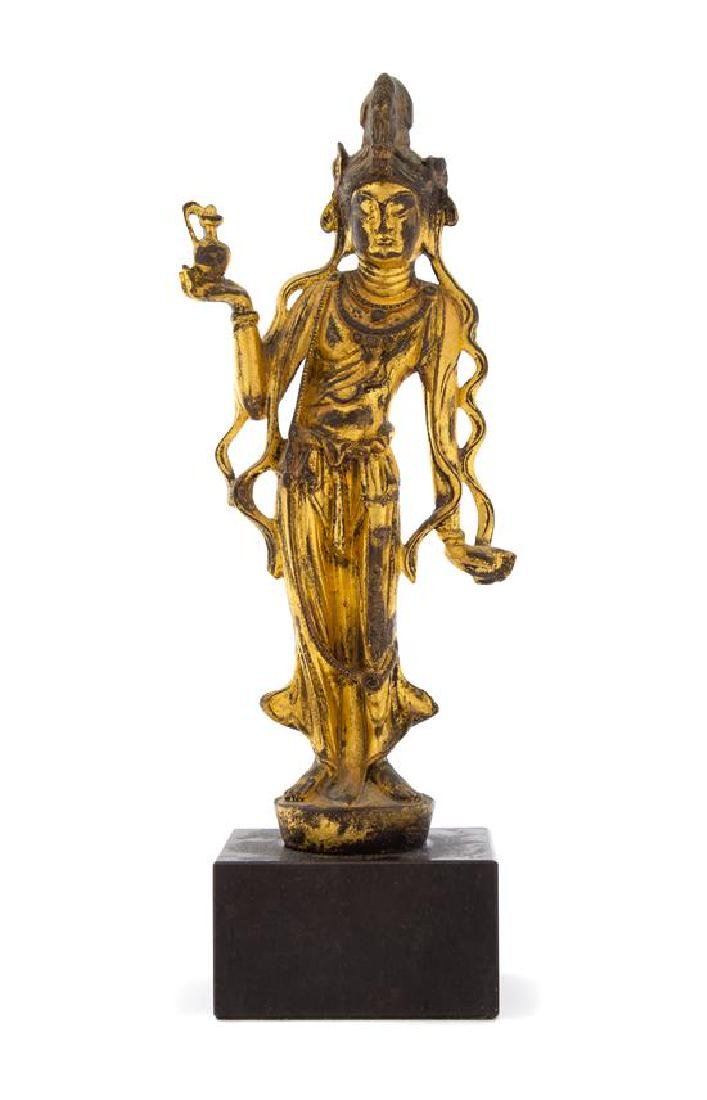 A Gilt Bronze Figure of a Guanyin Height 9 1/8 inches.