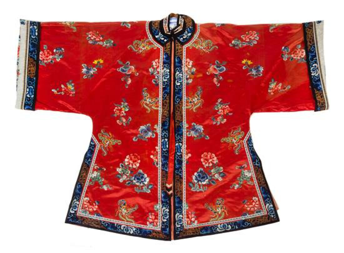 * A Chinese Red Ground Embroidered Silk Lady's Robe and