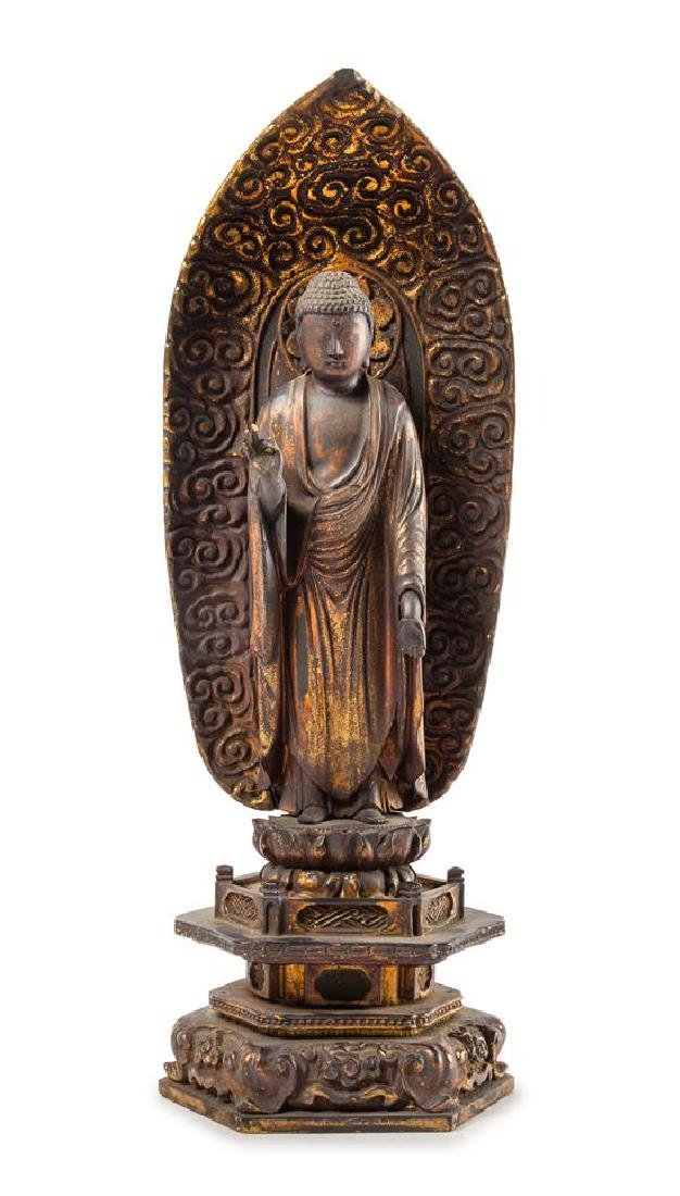 * A Japanese Gilt Lacquered Wood Figure of Buddha