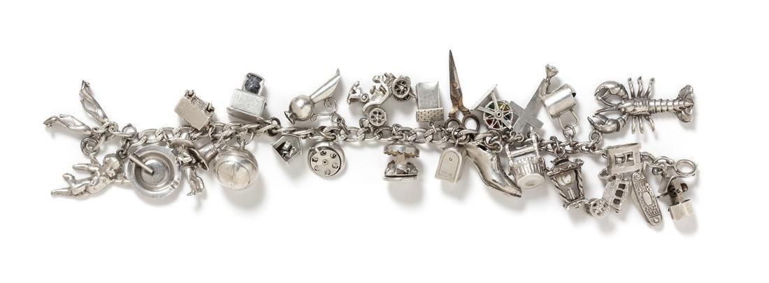 A Vintage Silver Charm Bracelet with Numerous Attached