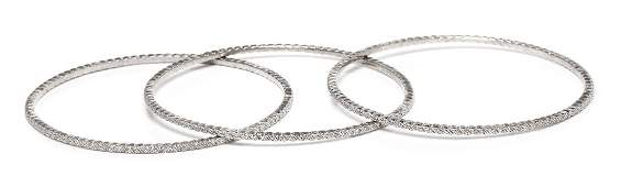 *A Collection of Sterling Silver and Diamond Bangle