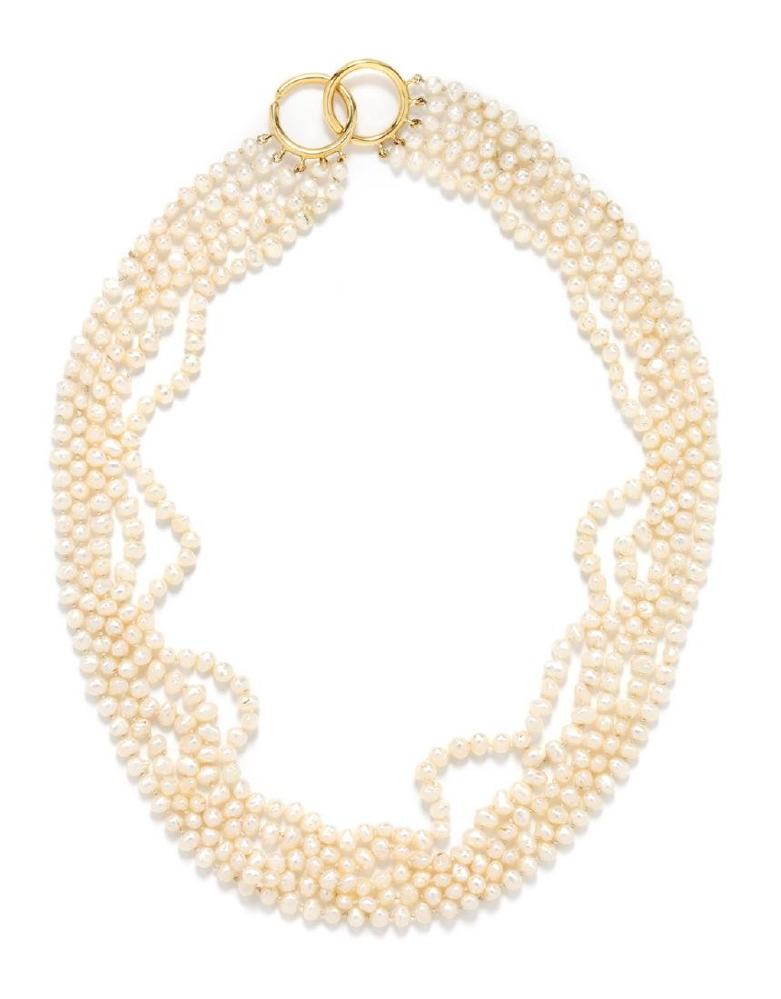 *An 18 Karat Yellow Gold and Cultured Freshwater Pearl