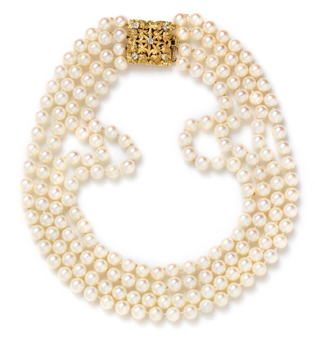 *An 18 Karat Yellow Gold, Diamond and Cultured Pearl