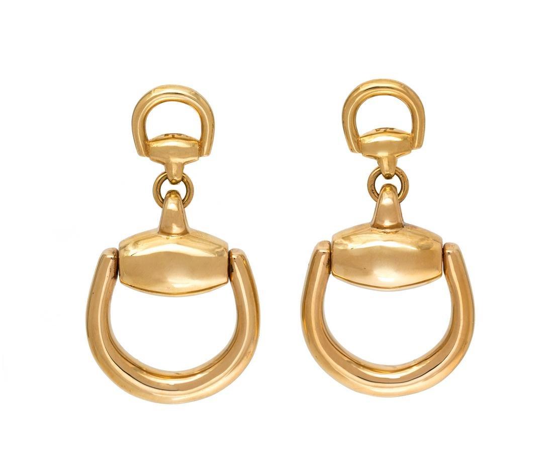 A Pair of 18 Karat Yellow Gold 'Horsebit' Earclips,