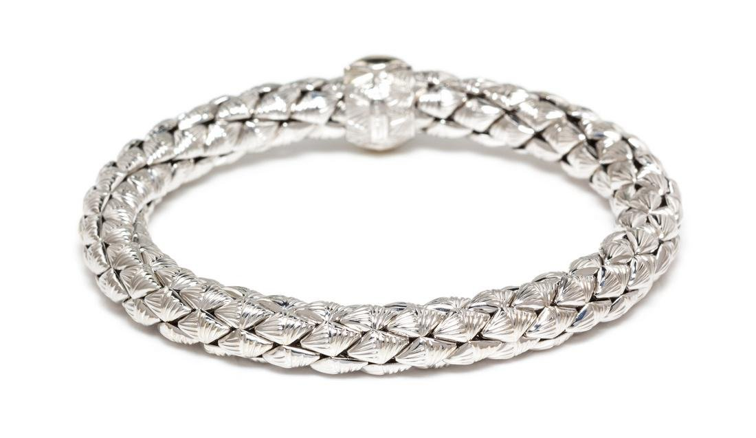 An 18 Karat White Gold and Diamond 'Stretch' Bracelet,
