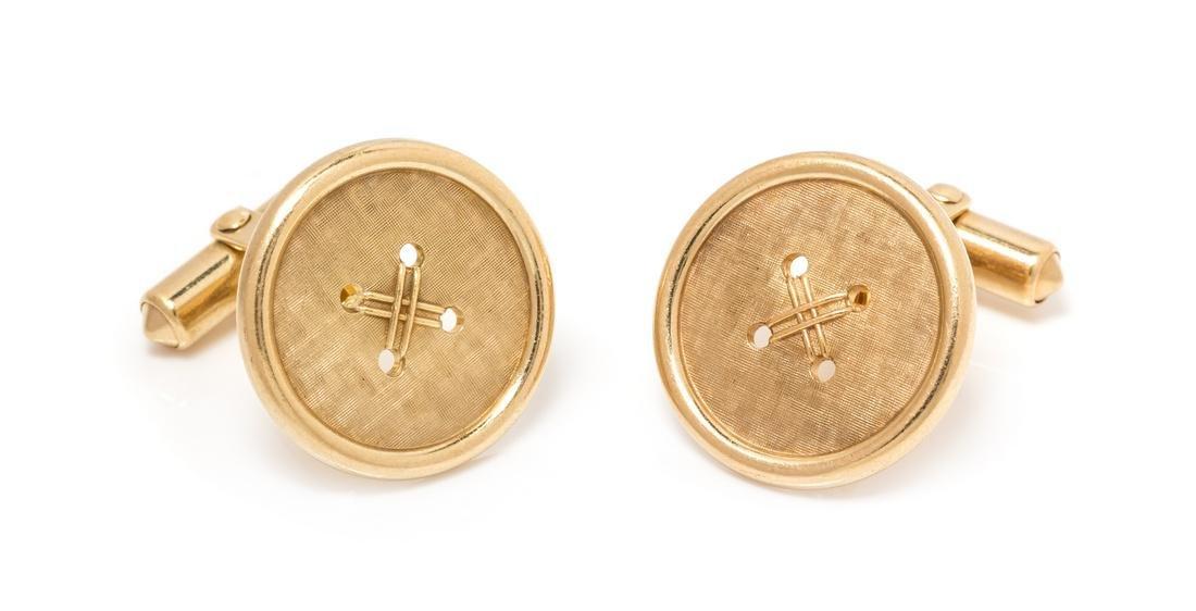 A Pair of 14 Karat Yellow Gold Button Motif Cufflinks,