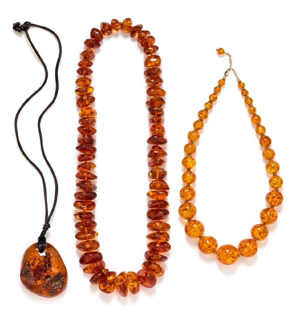 *A Collection of Amber Bead Necklaces and Pendant,