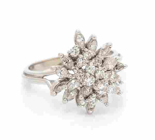 *An 18 Karat White Gold and Diamond Cluster Ring, 3.70