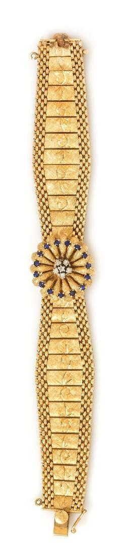A 14 Karat Yellow Gold, Sapphire and Diamond Surprise