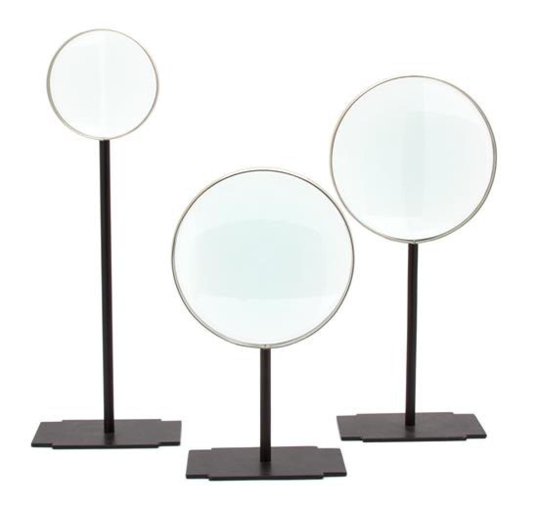 Three Metal Mounted Magnifying Glasses on Black Metal