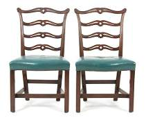 A Pair of Chippendale Style Carved Mahogany Ladder Back