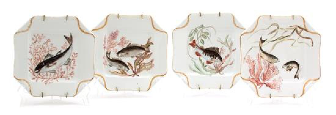 A Set of Four Limoges Porcelain Handkerchief Plates