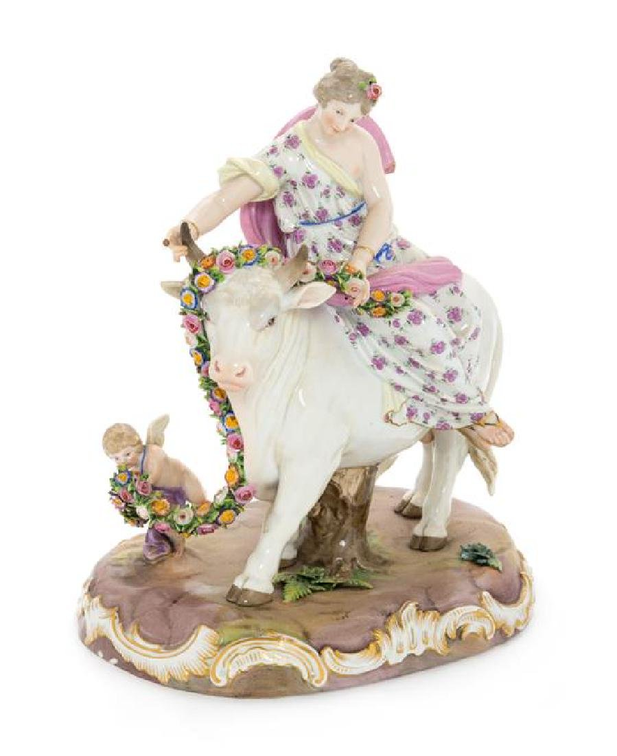 A Meissen Porcelain Figural Group Height 10 1/4 inches.