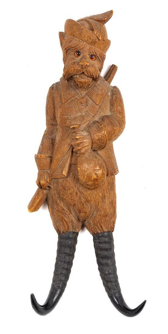 A Black Forest Carved Figural Dog Whip Hook Height 11