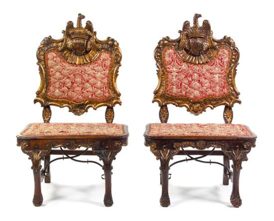 A Pair of Northern European Carved Giltwood Hall Chairs