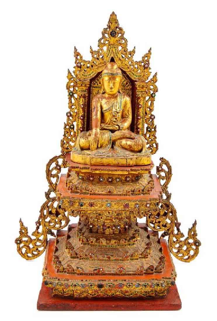 A Burmese Gilt and Red Laquered Wood Figure of Buddha