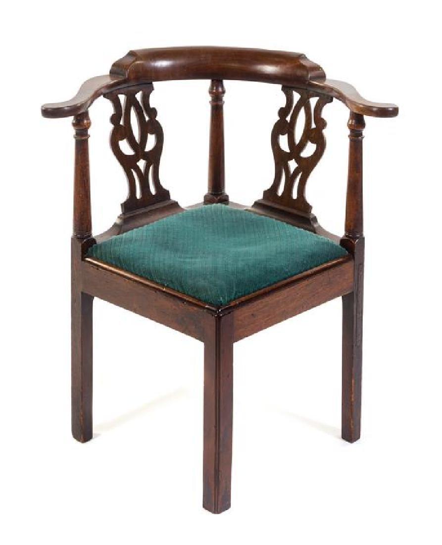 A George III Mahogany Corner Chair Height 32 inches.