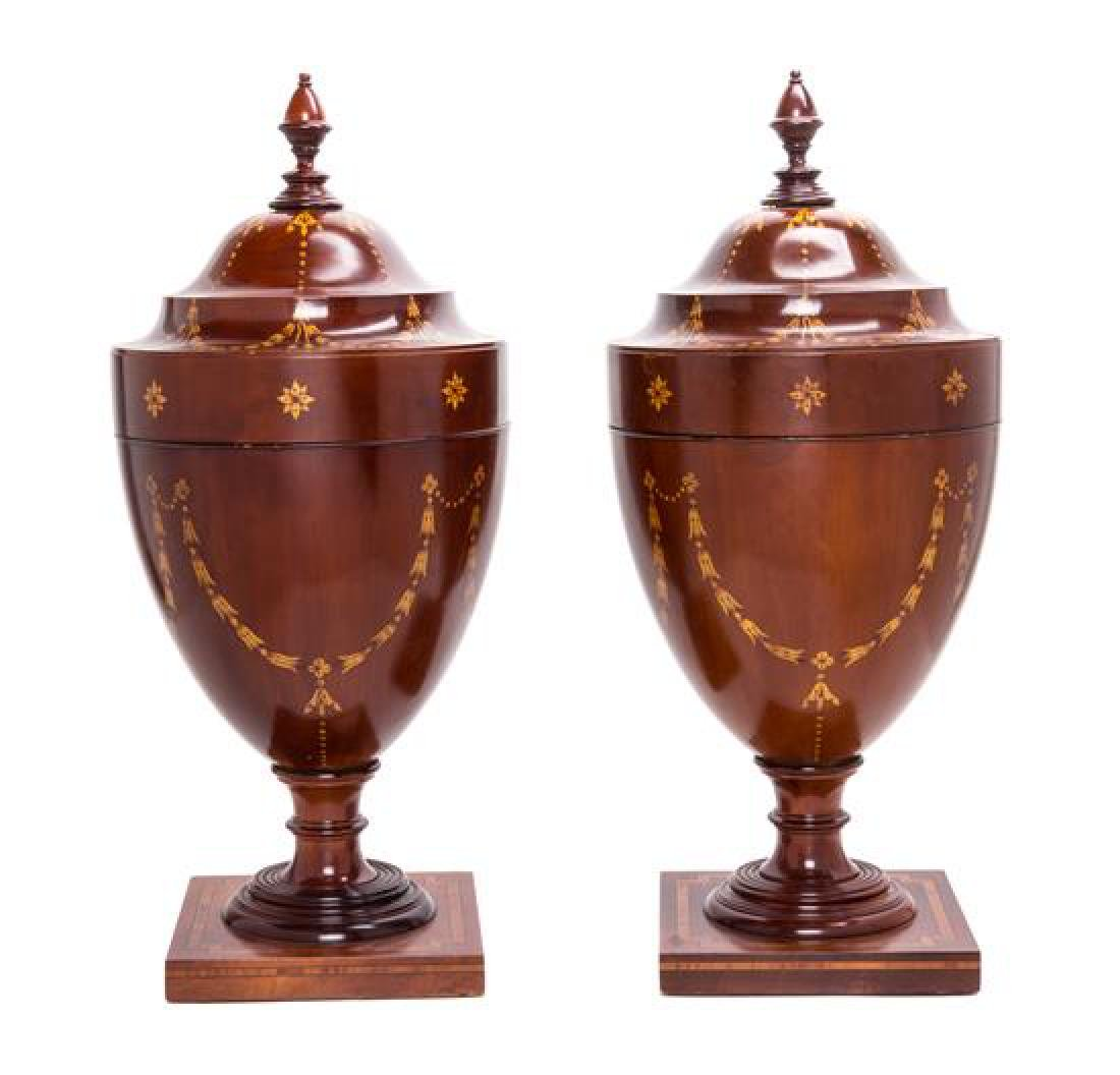 A Pair of George III Cutlery Urns Height 25 3/4 inches.