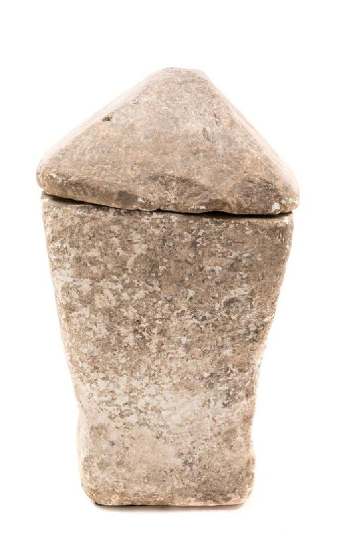 * A Carved Limstone Burial Urn and Cover Height 21
