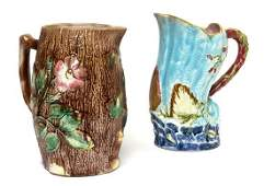 Two Majolica Pitchers Height of taller 10 inches.