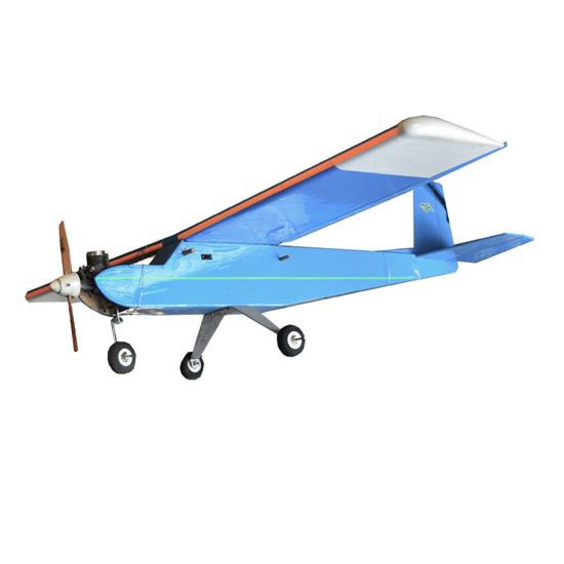 "A Remote Control Airplane 48"" W x 56"" D x 20"" H"