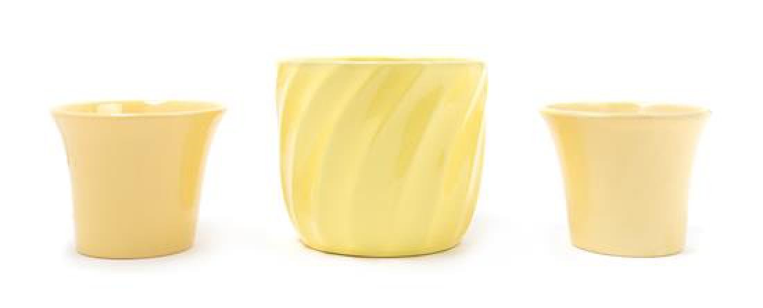 Four Yellow Glazed Molded Ceramic Vessels Height of