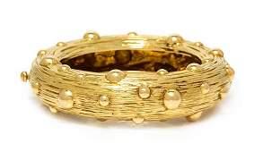 An 18 Karat Yellow Gold Bangle Bracelet Tiffany  Co