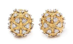 A Pair of 18 Karat Bicolor Gold and Diamond Domed
