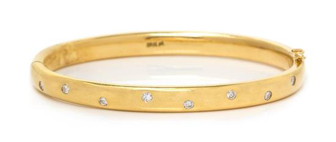 An 18 Karat Yellow Gold and Diamond Bangle Bracelet,