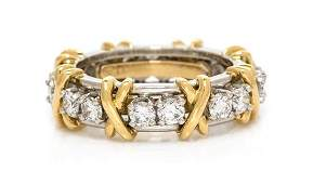 A Platinum, 18 Karat Yellow Gold and Diamond 'Sixteen