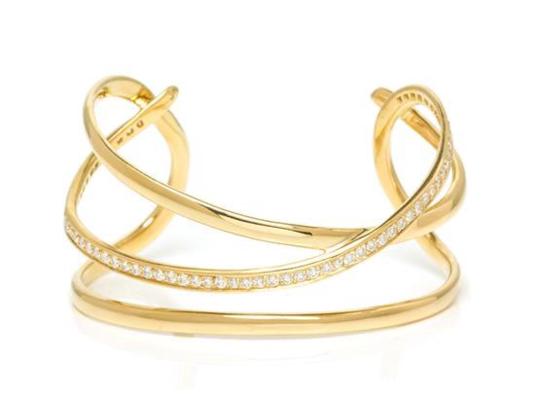 An 18 Karat Yellow Gold and Diamond Cuff Bracelet,