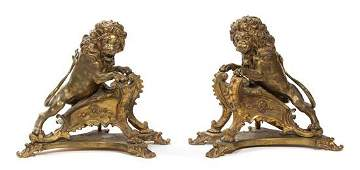 A Pair of French Gilt Bronze Figural Chenets and Fire