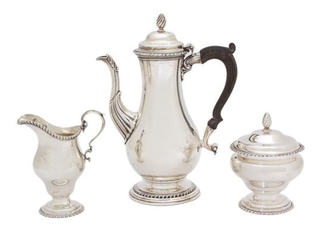 * An American Silver Coffee Pot with Treen Handle,