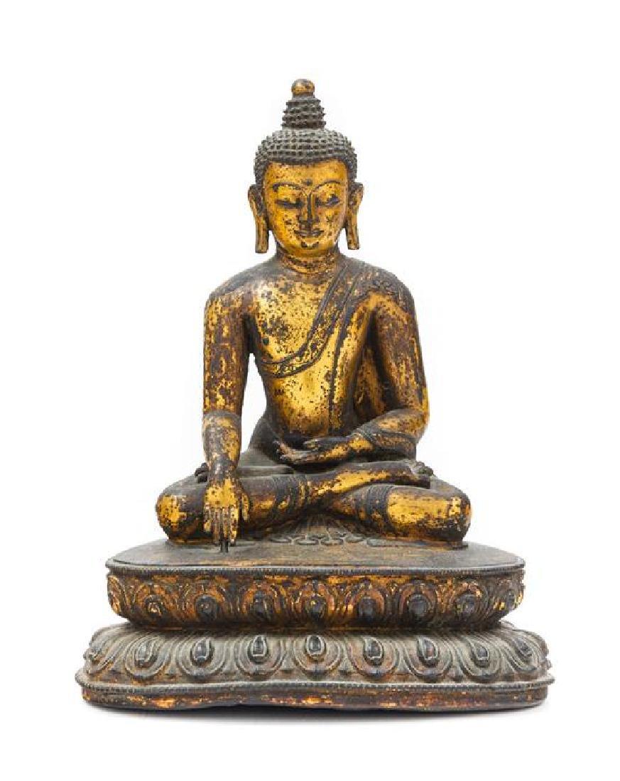* A Sino-Tibetan Gilt Bronze Figure of Buddha