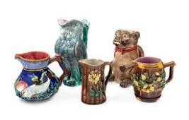 A Collection of Majolica Pitchers Height of tallest 9