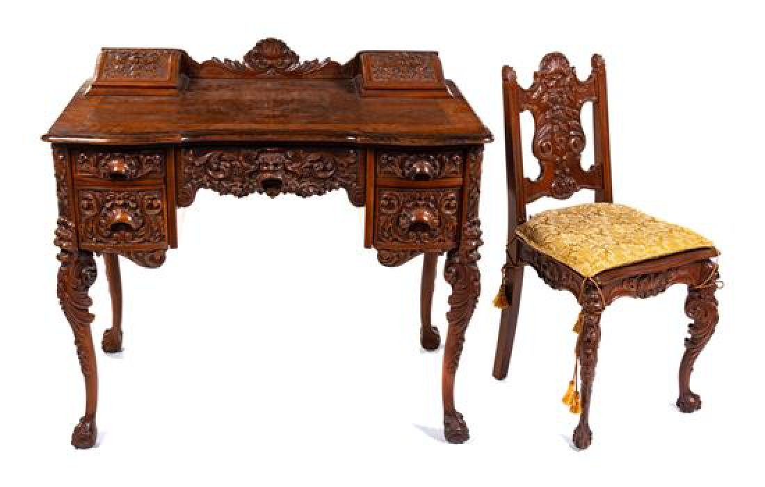 * An American Renaissance Revival Carved Desk and Chair