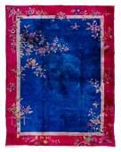 * A Chinese Wool and Silk Rug 11 feet x 9 feet.