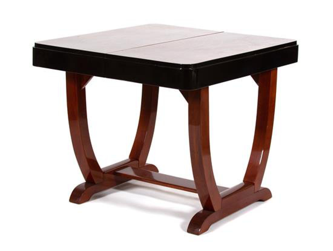 An Art Deco Mahogany and Black Lacquer Dining Table