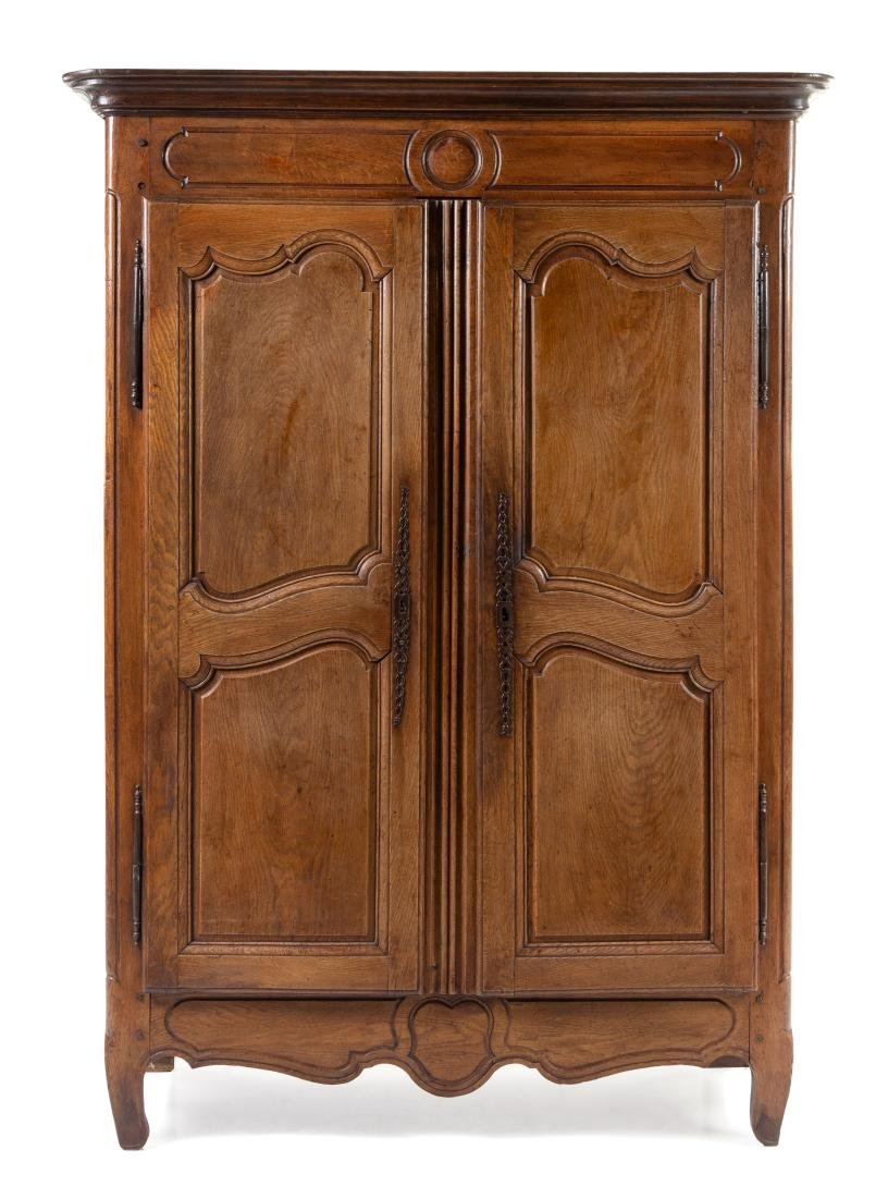 A Louis XV Provincial Walnut Armoire Height 77 x width