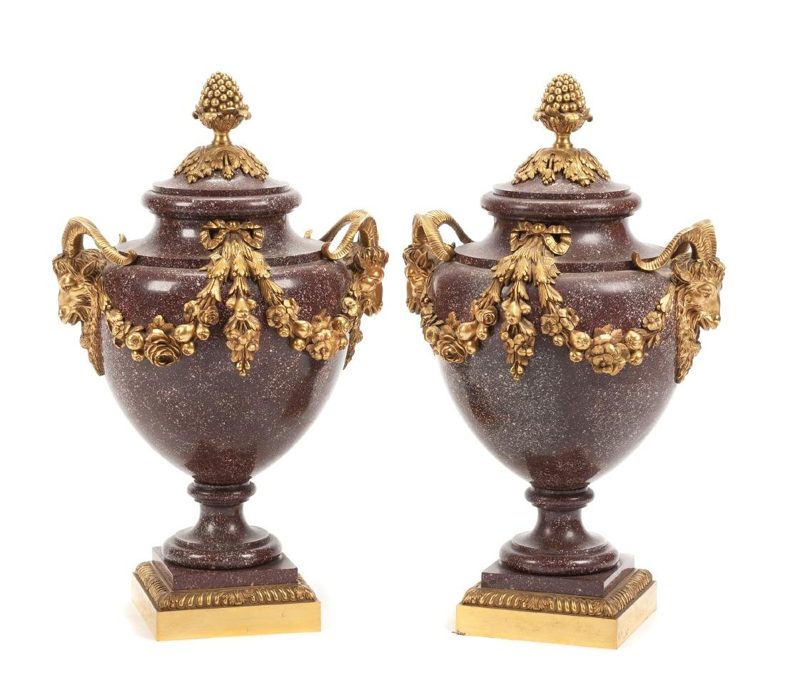 A Pair of French Gilt Bronze Mounted Porphyry Urns