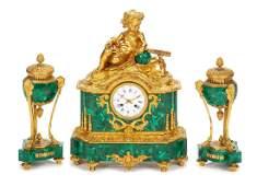A French Gilt Bronze and Malachite Clock Garniture