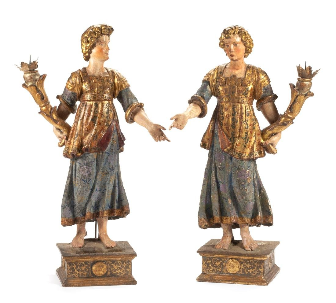 A Pair of Italian Painted and Parcel Gilt Figural