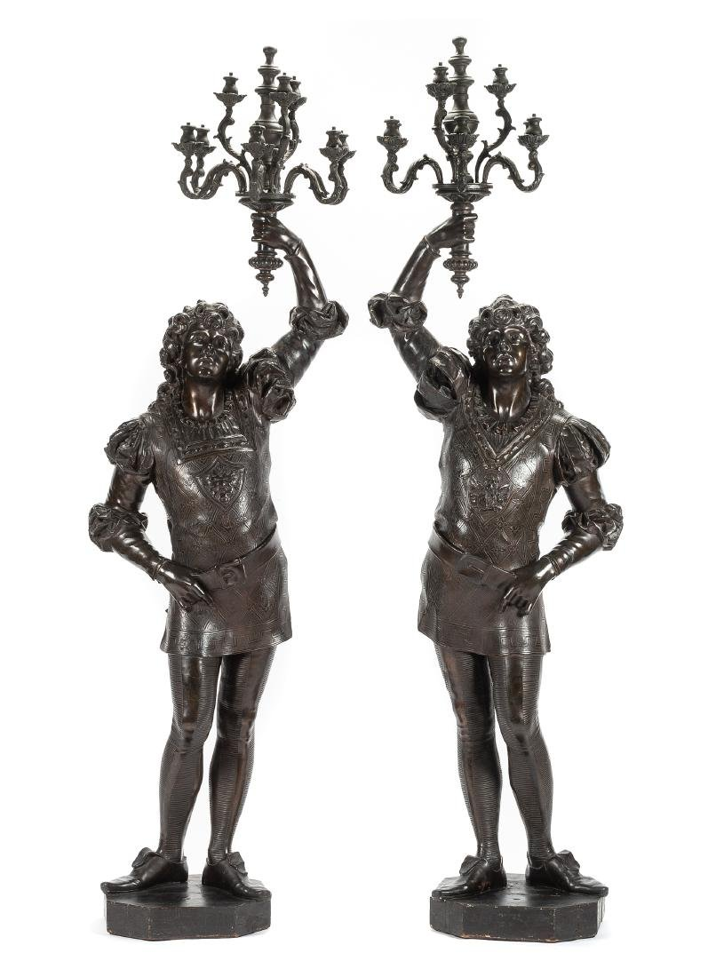 A Pair of Continental Carved Figural Torcheres Height