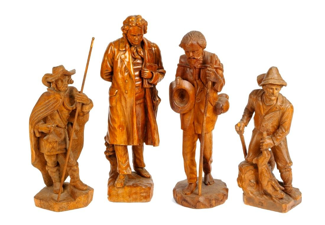 Four Continental Carved Wood Figures Height of tallest