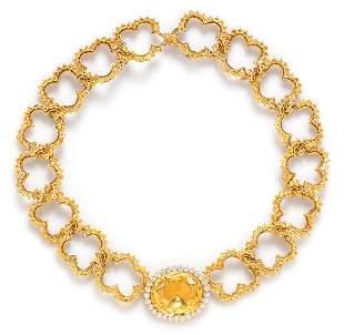 An 18 Karat Yellow Gold, Yellow Sapphire and Diamond
