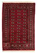 A Bokhara Wool Rug 5 feet 10 inches x 4 feet 2 inches.